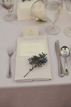 A way to fold the napkins. Square fold, place the fork and knife in the fold. Menu band around the cutlery?