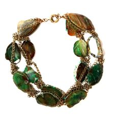 """Taigan.  Susanna Galanis AGE OF GODS Daphne Collection Fall '13Inspired by the glamour of ancient Greece, the myths and the legends. In the love story of Apollo and Daphne, Daphne turned into the immortal laurel tree. This necklace which was inspired by Daphne is featuring the most vibrant green agate semi precious stones. The chains wrapped are of vintage brass. Hand crafted in beautiful NYC. Limited in production.Length: 26"""""""