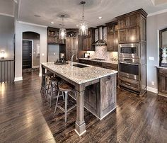Open Kitchen With Large Granite Island Beautiful Lighting And Hardwood Flooring Gallery New