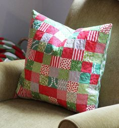 """The pillow cover is made with 2 1/2"""" squares…100 squares (10 x 10) makes a perfect 20"""" pillow cover.  I strip pieced the squares (sew 2 1/2"""" strips together…then cut the strip sets into 2 1/2"""" strips) so despite its appearance its actually a really fast project."""