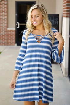 Keep the fashion decisions simple with this easy going striped dress! It adds major trending style with a criss-cross front, bell sleeves, & ribbed material!