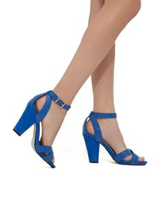 cutout, strappy style features a thick, graduated heel for added drama