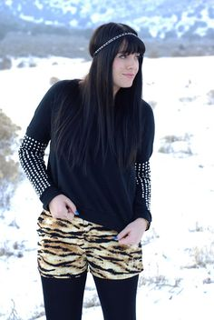 Wearing leggings with shorts in the winter. Leopard print and studs for a fun and edgy winter look. Outfit from the red closet diary blog.