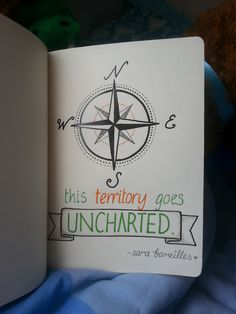 Sara Bareilles quote - 'This territory goes uncharted', part of a travel journal.