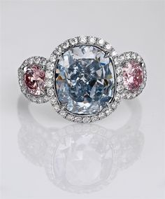 A natural fancy intense blue cushion-cut diamond is at the center of this handmade platinum ring, featuring round pink diamond side stones, all framed in white diamond accents. Blue Diamond Jewelry, Zen, Colored Diamonds, Blue Diamonds, Cushion Cut Diamonds, Pink Ring, Brilliant Diamond, Diamond Are A Girls Best Friend, Beautiful Rings