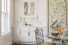 I love the chinoiserie details of the dining chairs, and the giant wallpaper panel. Transitional dining room by Lovejoy Designs