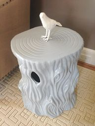 A repurposed stump from Home Goods
