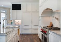Love the edging on the island counter top and the paneled fridge and freezer!  Family Home Interior Ideas