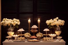 Elegant dessert bar- could use a set up like this (with candles and tall vases of flowers) for your milk and cookie idea too!