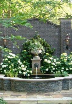 Lions Head fountain on Garden wall. Lions Head fountain on Garden wall. Hydrangea Landscaping, Front Yard Landscaping, Landscaping Borders, Natural Landscaping, Florida Landscaping, Mulch Landscaping, Formal Gardens, Outdoor Gardens, Landscape Design