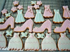 adorable wedding themed cookies  we could make them ourselves and have like tea in cute tea pots cause it will be a day situation and fun and games and hens is the booze up do we agree