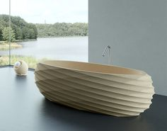 The characteristics of the cork material used in this unique bathtub offer a naturally soft and comfortable seating position, whilst being extremely strong and resilient nonetheless. Wooden Bathtub, Wooden Bathroom, Fine Furniture, Furniture Decor, Furniture Design, Bathroom Collections, Bathroom Inspiration, Bathroom Ideas, Innovation Design