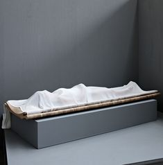 Dutch Design Week: at the Design Academy Eindhoven graduation galleries last week, designer Roos Kuipers presented an open coffin where the dead body is gradually covered in layers of fabric.