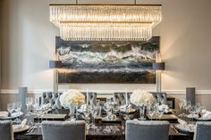 LUXURIOUS DINING ROOM |  This very luxurious dining room ambience has such a dreamy decoration with blue velvet details. | bocadolobo.com/ #diningroomdecorideas #moderndiningrooms