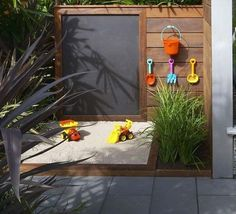 Modern sandbox and chalk wall - 25 Playful DIY Backyard Projects To Surprise…