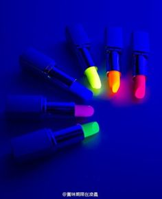neon lip sticks that glow in the dark - perfect for a fun summer night out!  ^.^ (found some on amazon)