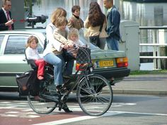 Woman with 3 kids on a bike ..Amsterdam 2005