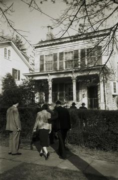 <b>Not published in LIFE.</b> Family and friends return to Einstein's home at 112 Mercer Street in Princeton, where he lived for 20 years, after his funeral, April 18, 1955.