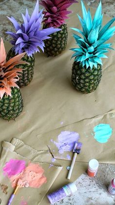Painted pineapples-possible decoration for Hawaiian themed event...