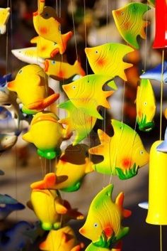 detail of colorful handmade wind chimes with fish motives Stock Photo - 6668850