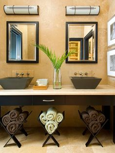 Using wooden magazine racks for decorative towels will be great for extra floor space in the bathroom!