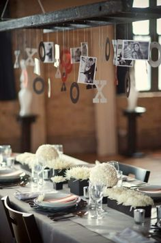 Hanging pictures over dinner table... nice idea.