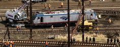 Emergency workers inspect the engine of a derailed Amtrak train in Philadelphia. (Reuters)