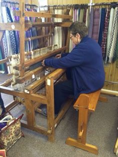 Worsted weavers, spinners and dyers: Jenny Rose demonstrating the 8 shaft weaving loom.