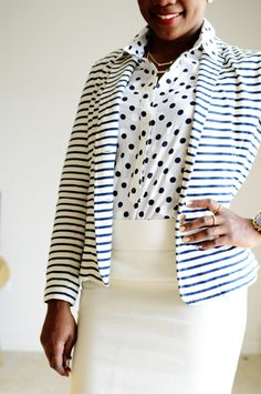 I love this outfit. Its clean, well executed, and work environment appropriate. I would wear this outfit as is.  Notice the scale of the prints. They are roughly the same size. Make sure when you are mixing prints you keep this in mind.  For the bold; a crimson skirt or trouser in place of the white skirt would look gorgeous with this combination.  Let us know what you think