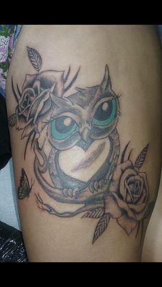 My finish owl tattoo with roses and a butterfly