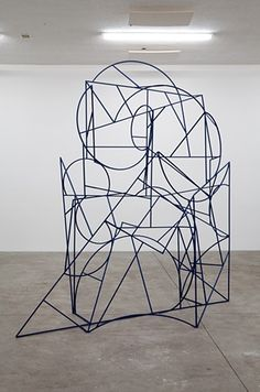 I really like the geometric forms used in this one.  the contrast of the circles with the angular squares draws viewers eyes all around the sculpture
