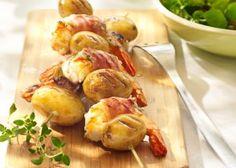 Aardappelspiesjes met scampi's, spek en geitenkaas