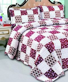 This is a super cute bedding quilt set.   Burgundy Jasmine Three-Piece Reversible Quilt Set