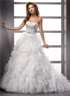 Wedding dress with ruffle skirt and crystal-accent bodice.
