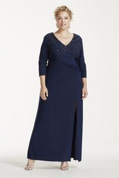 Sparkle and shine in this stunning Mother of the Bride dress!  3/4 Sleeve v-neck bodice features elegant formal beading.  Long soft jersey with ruched waist and side slit make this a comfortable evening gown.  Fully lined. Center back zip. 95% Polyester, 5% Spandex. Spot clean only.Also available in Missy sizes as Style 262330I.