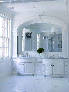 Maximize your bathroom's lighting with the streamlined look of mirror-mounted sconces.