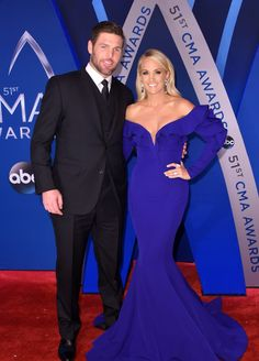 Carrie Underwood and Mike Fisher at the red carpet for the 2017 CMA awards