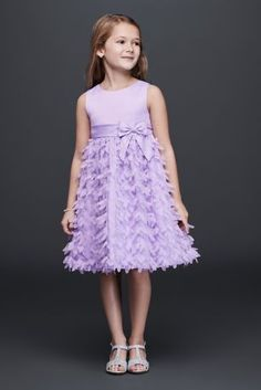 The skirt on this darling flower girl dress is richly textured with 3D flowers that bloom down the entire length. A perfectly tied bow at the hip sweetly completes the look.  By American Princess  Polyester  Back zipper; fully lined  Dry clean  Imported