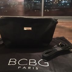 BCBG Paris black purse and dust bag NWOT BCBG Paris black purse and dust bag!  NWOT I have soooo many black purses need to slim down a little - never been used or worn BCBG Bags Crossbody Bags
