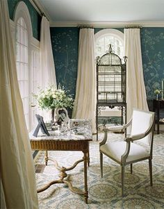 Silk taffeta curtains, a Louis XVI writing desk. Custom hand-painted de Gournay wall panels. Ceiling paint is Fog Mist by Benjamin Moore.