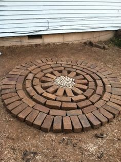 DIY: Brick Patio Tutorial Good for area between raised beds and sidewalk.  Fit in rocks, etc. in pattern.