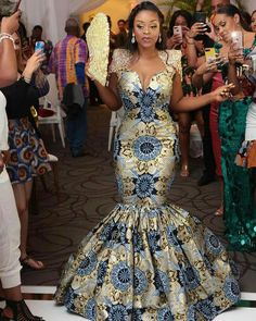 ankara mode Ankara gowns are beautiful and we've got more than enough ankara long gown styles you'll love in this post. African Lace Dresses, Latest African Fashion Dresses, African Dresses For Women, African Print Fashion, Ankara Fashion, African Wedding Attire, African Attire, Ankara Long Gown Styles, Ankara Gowns