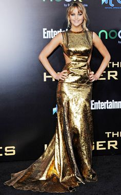 """Jennifer Lawrence rocks a gold lamé Prabal Gurung at the premier of The Hunger Games. No dress says """"This is MY night, bitchez!"""" better than that."""