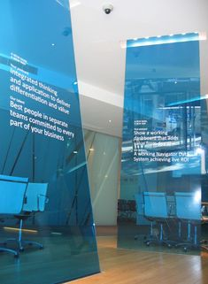 blue semi-opaque divider walls in office space