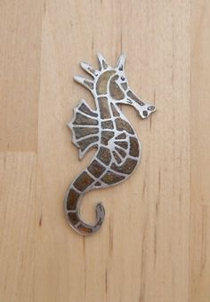 Seahorse brooch etched in pewter £18.00 by Jewellery By Silvana