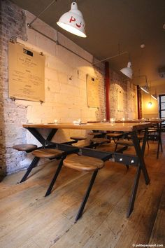 Flat Iron London by Petite Passport - interesting table/chairs but more the exposed walls and lighting