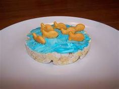 Rice cake, cream cheese with food coloring, goldfish for a Sea World themed party