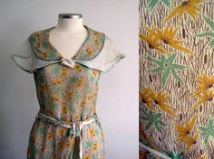 Museum quality, gorgeous 1930s summer dress in cotton voile with a green and yellow floral print with brown cattails.