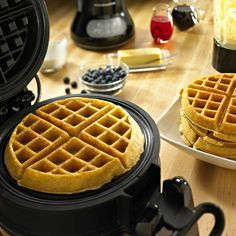 "Make true Belgian waffles in your own kitchen. In just five minutes, the KitchenAid® Pro Line™ waffle maker cooks two 7 1/2"" w x 1 1/4"" thick Belgian waffles with ample, deep wells for yummy toppings."