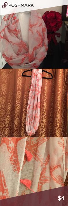 🎁Infinity Scarf🎁 🎁Fashionable coral and white infinity scarf with coral color tassels. Does have a defect as shown in picture    but is easily hidden and can be worn without the flaw being noticed. If you purchase two items you can pick this as a free item🎁 Accessories Scarves & Wraps